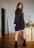 Birds of North America Clothing Toronto Emu Dress. Long Sleeve Short Hem Patterned Black Mini Dress with Neck Tie.