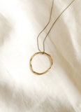 Hawkly Jewelry Toronto Wabi Necklace Bronze or Silver. Metal Minimalist Circle Pendant with Chain. Free Shipping in Canada. Canadian Design. Canadian Jewelry. Victoire Boutique.