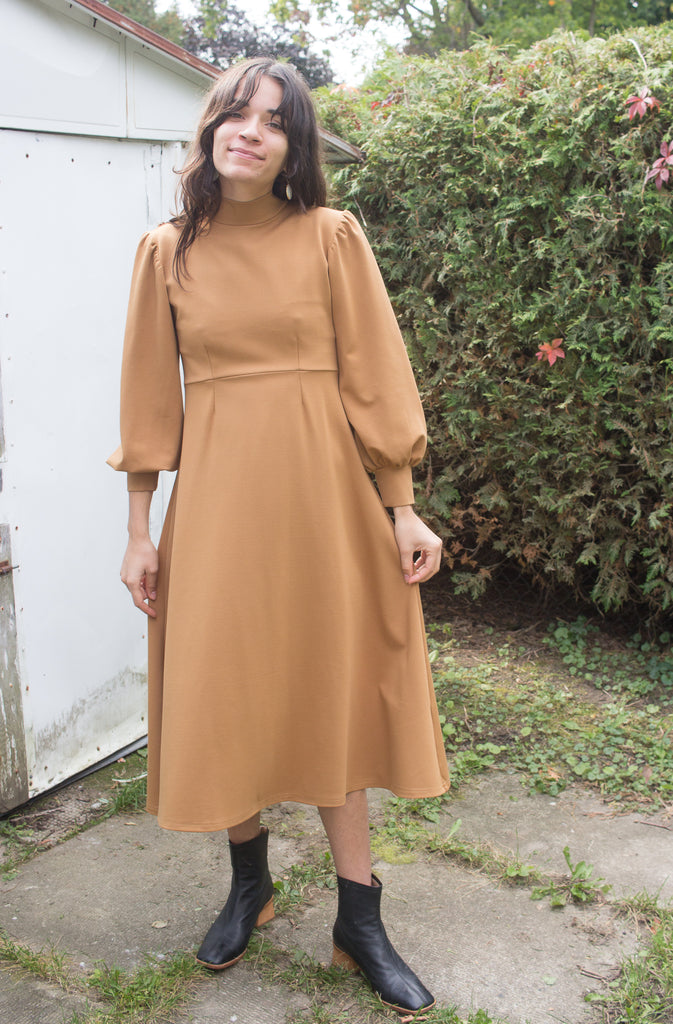 Eliza Faulkner Clothing Montreal Quebec Louise Dress Caramel. Long Sleeve Midi Puff Sleeve Fitted Dress with Tie. Dramatic Oversized Whimsical Feminine Clothing.