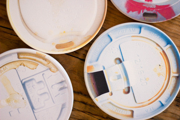 Designer coffee lid coasters by Jennifer Daniels