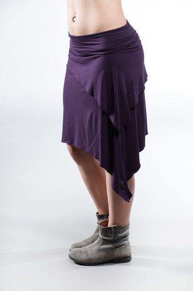 The Medium Gypsy Skirt is a unique, sexy skirt that's a must for any woman's closet! This versatile skirt has an optional side cinch that create a fantastic, flattering fit. It falls on your lower thigh making it great for layering. The angled, layered top and U-shaped hem accentuates the female form while creating a versatile, flowy style.