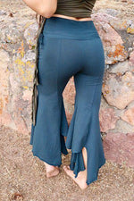 The Gypsy Pants are the perfect flowy dancing, yoga, or casual pants. These seven-eighths, asymmetrical, flared, folded top, cotton fairy pants make flattering, sassy pants for most body sizes