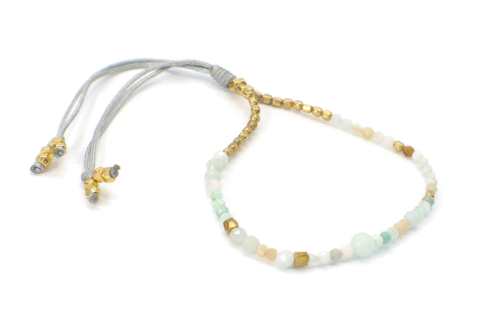 This is a single strand gemstone bracelet. Perfect for someone with a natural style. This is made with aquamarine and amazonite gemstones. They are combined with gold beads. This bracelet is handmade with love in Thailand. This is a Fair Trade Product.