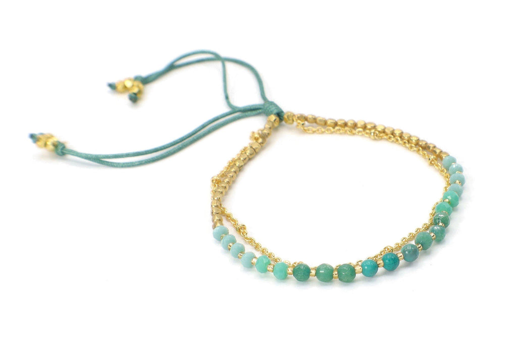 This beautiful ombre palette of turquoise is made with turquoise gemstones, czech glass gold beads to create make this delightful combination.  It is offset with a gold chain.
