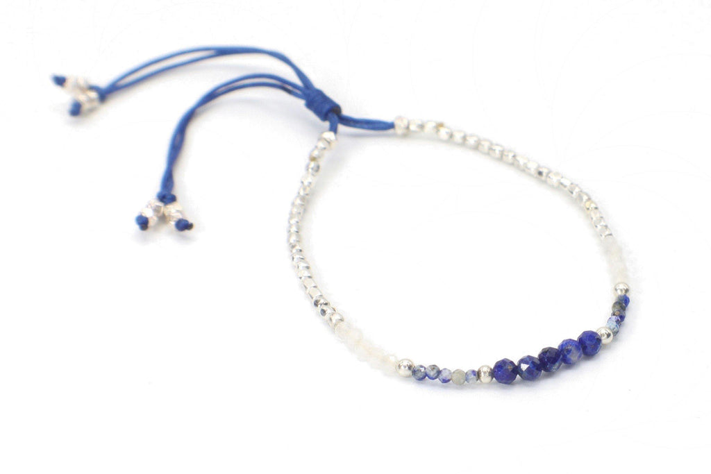 Celeste - Dark Blue | Silver. This single strand minimalist gemstone bracelet is perfect for stacking with the rest of your collection. The faceted lapis lazuli, sodalite, and crystal quartz gemstones are combined with silver beads. This bracelet is handmade with love in Thailand. This is a Fair Trade Product.