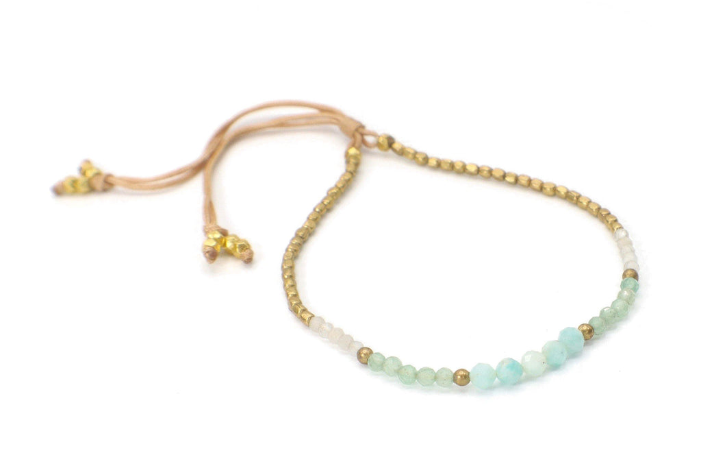 Celeste Bracelet - Light Blue. This single strand minimalist gemstone bracelet is perfect for stacking with the rest of your collection. The faceted aquamarine, gemstones, and crystals are combined with gold beads. This bracelet is handmade with love in Thailand. This is a Fair Trade Product.