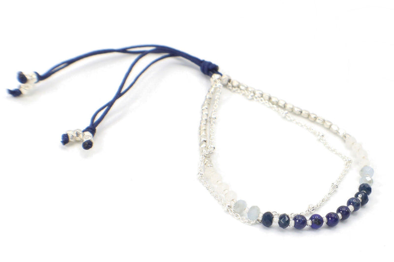Catalina Bracelet - Blue. This is an elegant two strand beaded bracelet made with Lapis Lazuli gemstones, silver beads, and a silver-plated chain. This bracelet is handmade with love in Thailand. This is a Fair Trade Product.