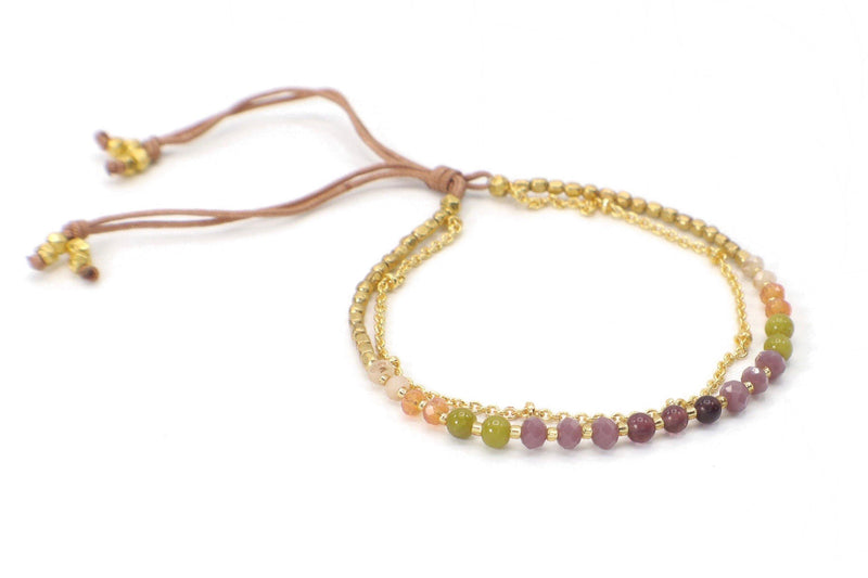 Catalina Bracelet - Tourmaline. This is an elegant two strand beaded gemstone bracelet made with Tourmaline gemstones, gold beads, and a gold plated chain. This bracelet is handmade with love in Thailand. This is a Fair Trade Product.