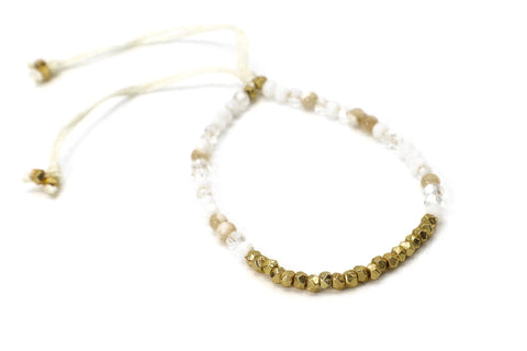 Milagros Bracelet. This is a single strand beaded bracelet with agate gemstones, crystals, and gold beads.  It is easily adjustable on a silk  cream colored cord.  This bracelet is handmade with love in Thailand.   This is a Fair Trade Product.