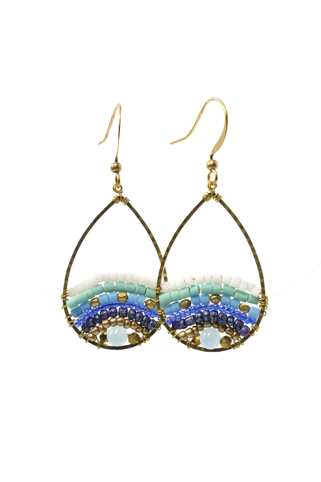 These are small teardrop island-style beaded earrings with fantastic shades of blue. They feature Afghani style tube beads, brass and acrylic beads. They are handmade with love in Thailand. This is a Fairtrade Product.