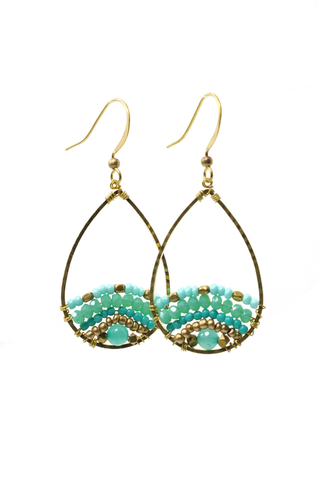 These are small teardrop island style beaded earrings with fantastic shades of turquoise.  They feature Afgani style tube beads, brass and acrylic beads. They are handmade with love in Thailand.   This is a Fairtrade Product.