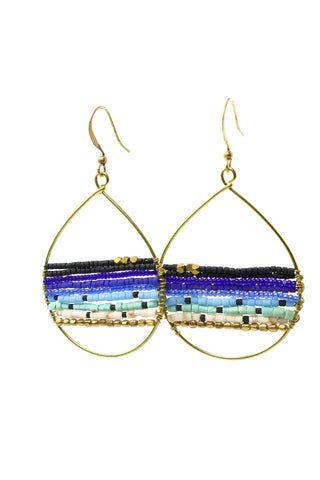 These are a statement teardrop beaded earring in dark blue. They feature Afghani style tube beads, brass and acrylic beads. They are handmade with love in Thailand. This is a Fairtrade Product.