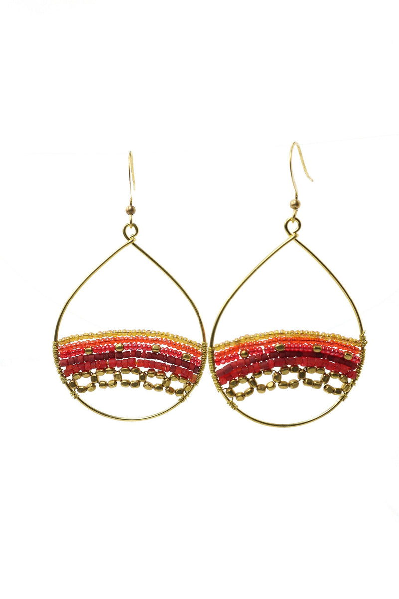 These are a statement teardrop beaded earring in red. They feature Afghani style tube beads, brass and acrylic beads. They are handmade with love in Thailand. This is a Fairtrade Product.