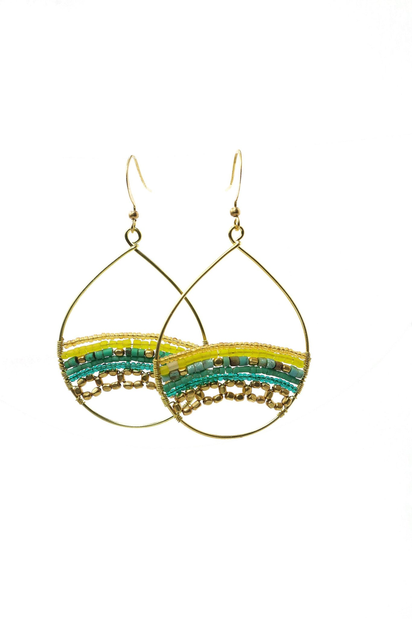 These are a statement teardrop beaded earring in green. They feature Afghani style tube beads, brass and acrylic beads. They are handmade with love in Thailand. This is a Fairtrade Product.