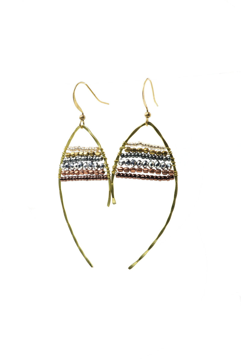 These are statement fish-shaped brass beaded earrings in gold, silver, and copper. They feature brass and acrylic and glass beads. They are handmade with love in Thailand. This is a Fairtrade Product.