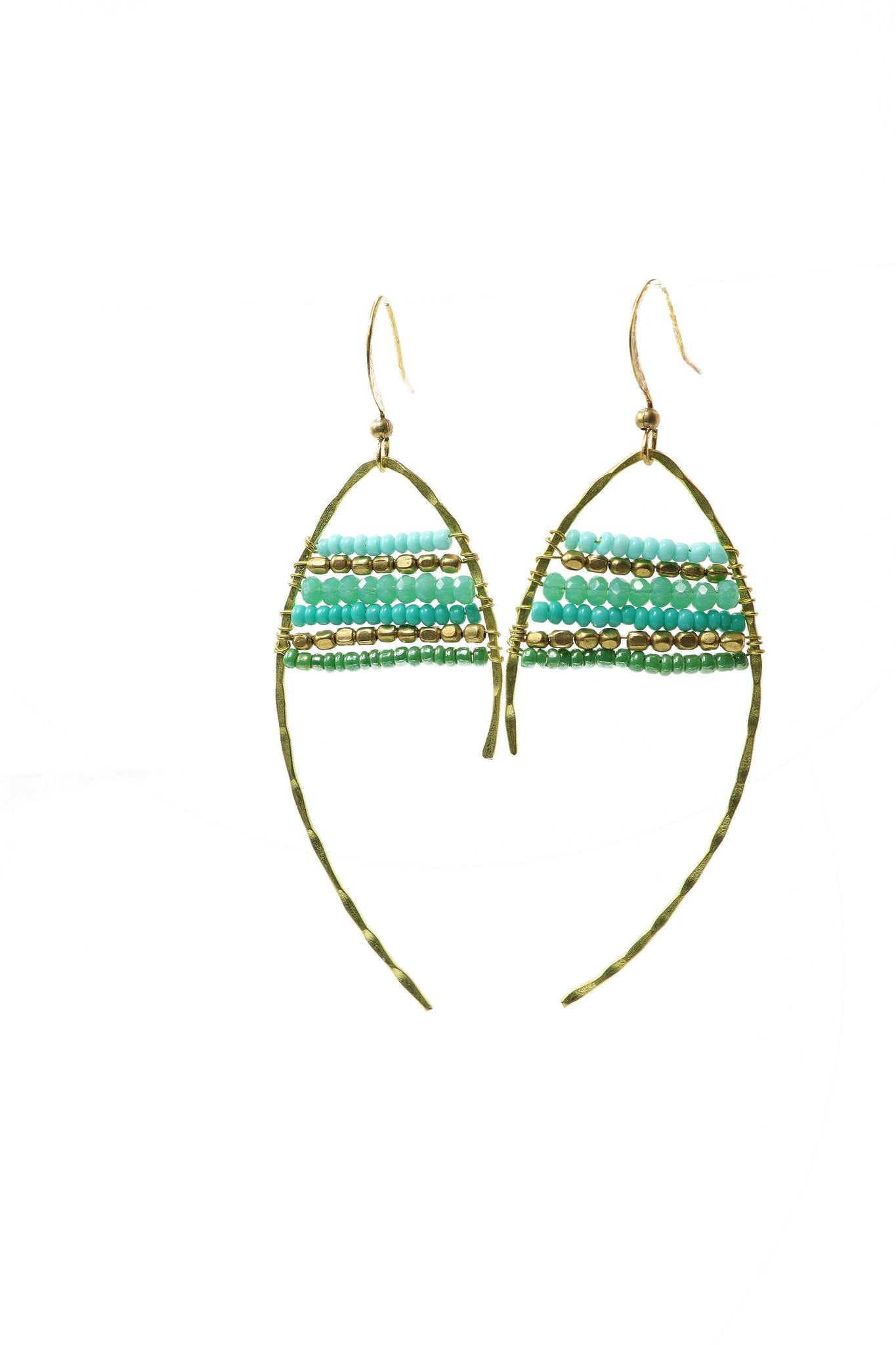 These are statement fish-shaped brass beaded earrings in shades of turquoise. They feature brass and acrylic and glass beads. They are handmade with love in Thailand. This is a Fairtrade Product.