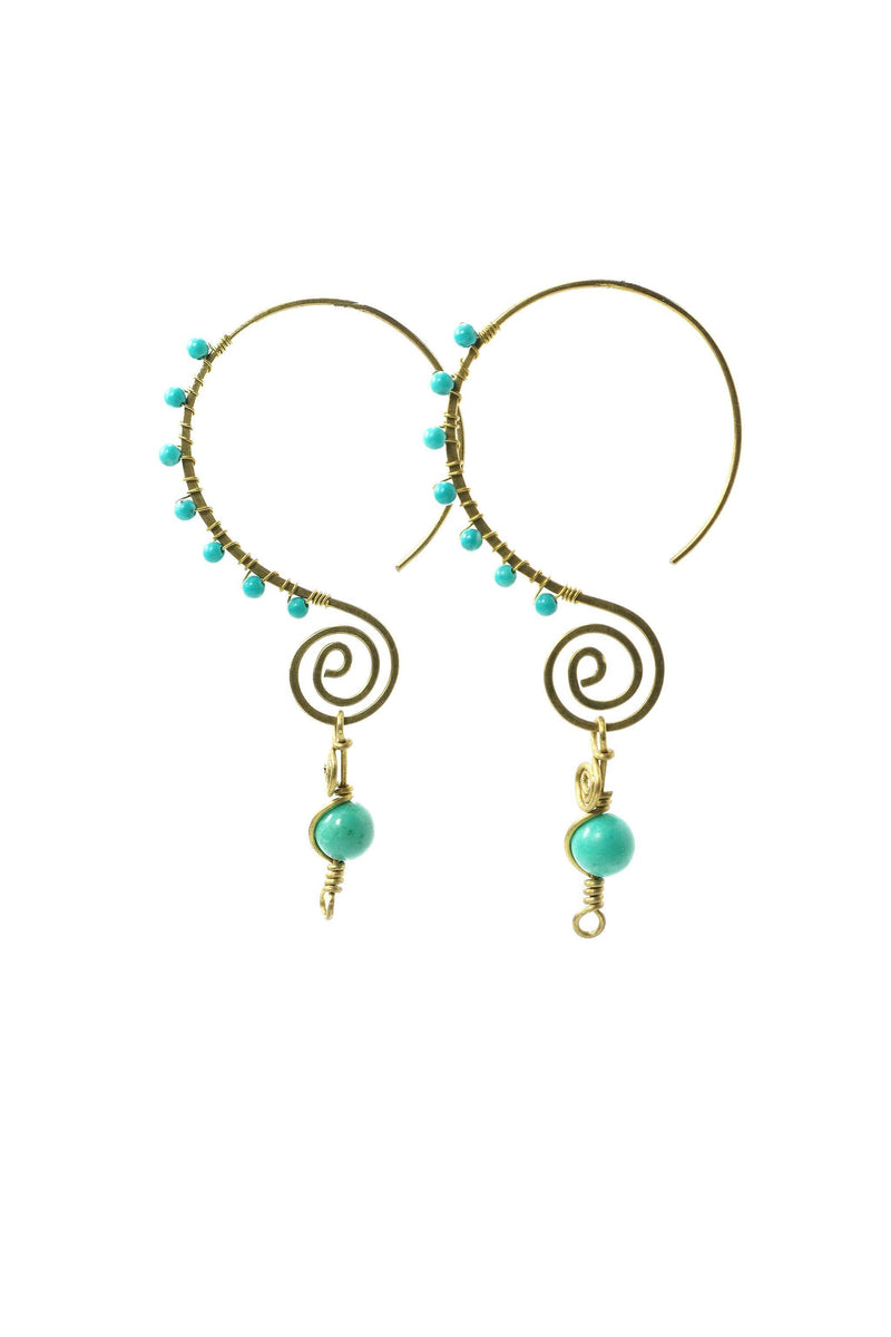 These handmade, brass, swirl earrings feature a fun infinity style hoop, wire wrapped with small gemstones, and finished with a larger turquoise gemstone as a focal point. This product is handmade and fairtrade in Thailand.