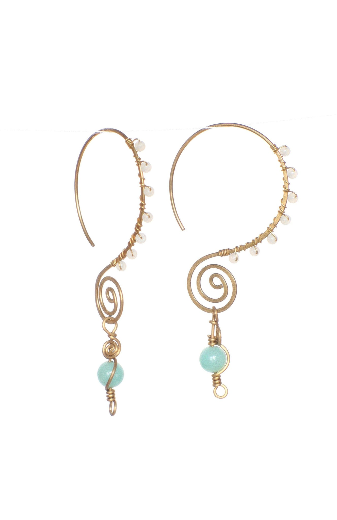 These handmade, brass, swirl earrings feature a fun infinity style hoop, wire wrapped with small gemstones, and finished with a larger aquamarine gemstone as a focal point. This product is handmade and fairtrade in Thailand.