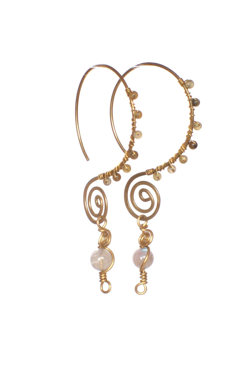 These handmade, brass, swirl earrings feature a fun infinity style hoop, wire wrapped with small gemstones, and finished with a larger labridorite gemstone as a focal point. This product is handmade and fairtrade in Thailand.