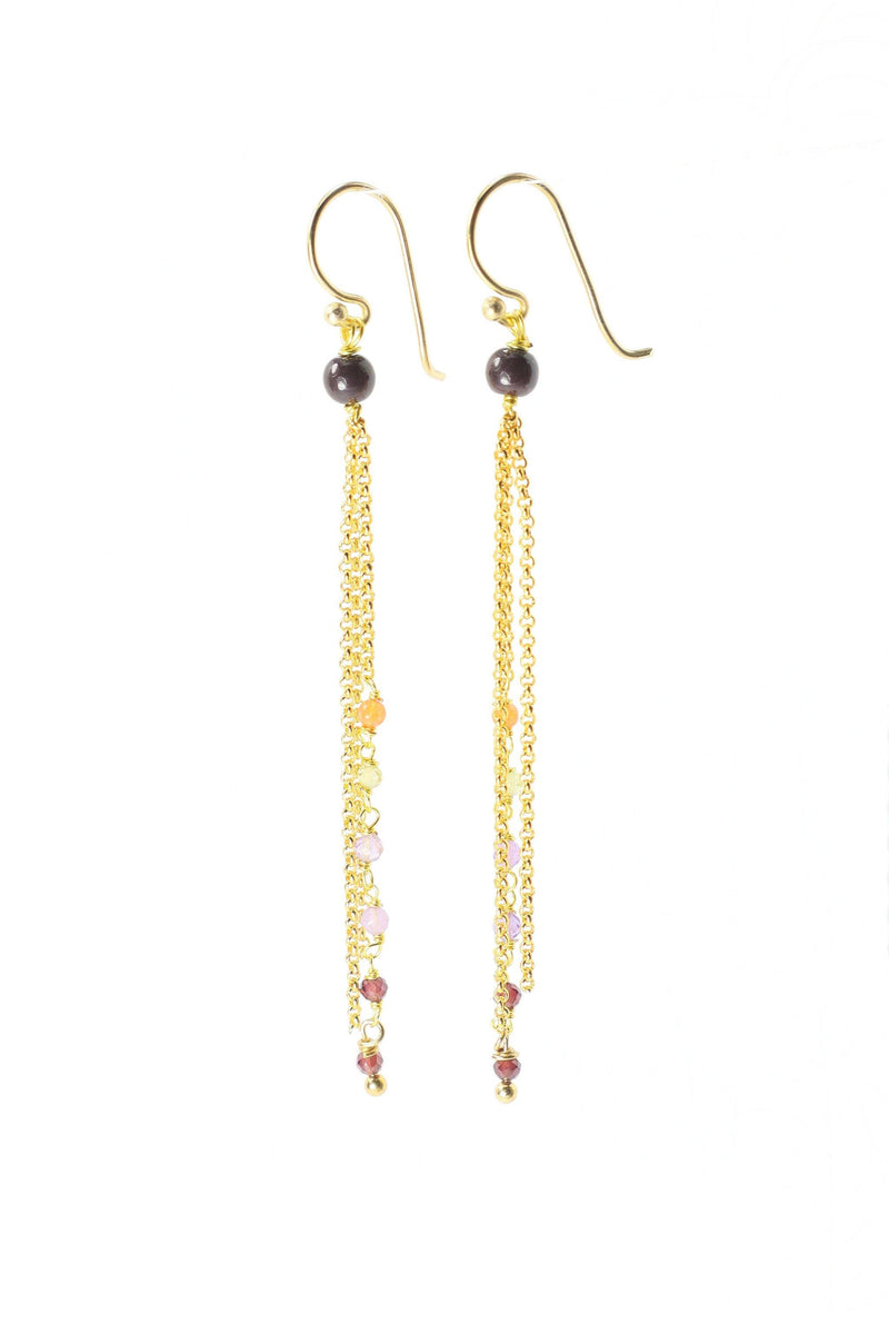 These earrings are a triple strand of rosary style gemstones and chains. The faceted carnelian, peridot, amethyst and garnet are wired in a graduated tone of light to dark. These earrings are handmade with love in Thailand. This is a Fair Trade Product.
