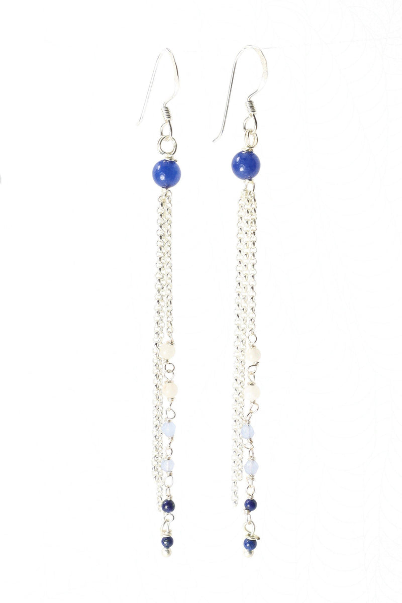 These earrings are a triple strand of rosary style gemstones and chain.   The faceted white quartz, light blue crystal and lapis gemstones are  wired in a graduated tone of light to dark.   These earrings are handmade with love in Thailand.   This is a Fair Trade Product.