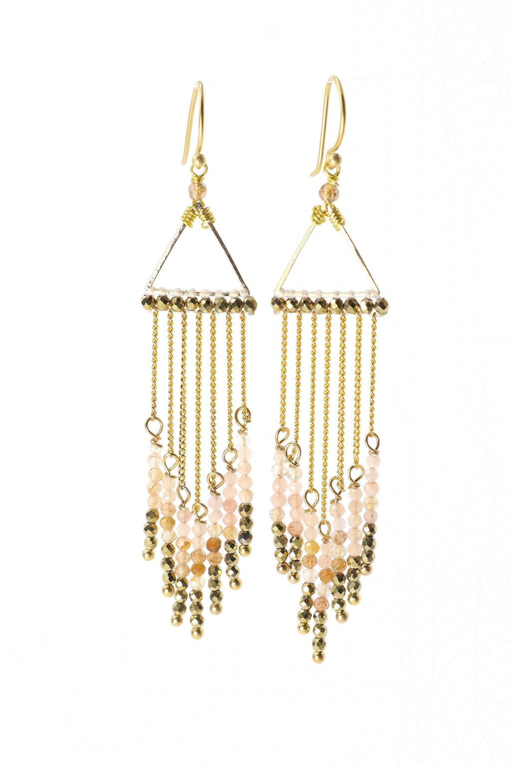 These waterfall statement earrings are a show stopper. They feature beautiful, faceted rose quartz, citrine, and pyrite gemstones hanging from a golden triangle in graduated tones from light to dark. They are handmade with love in Thailand. This is a Fairtrade Product.