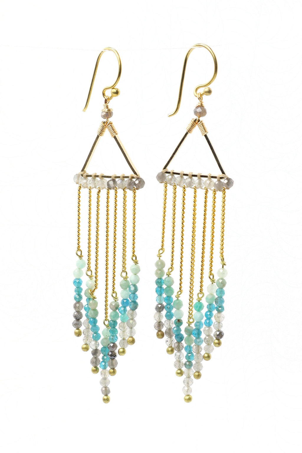 These waterfall statement earrings are a show stopper. They feature beautiful faceted aquamarine, apatite, and smokey quartz gemstones hanging on a gold chain from a gold triangle. They are handmade with love in Thailand. This is a Fairtrade Product.