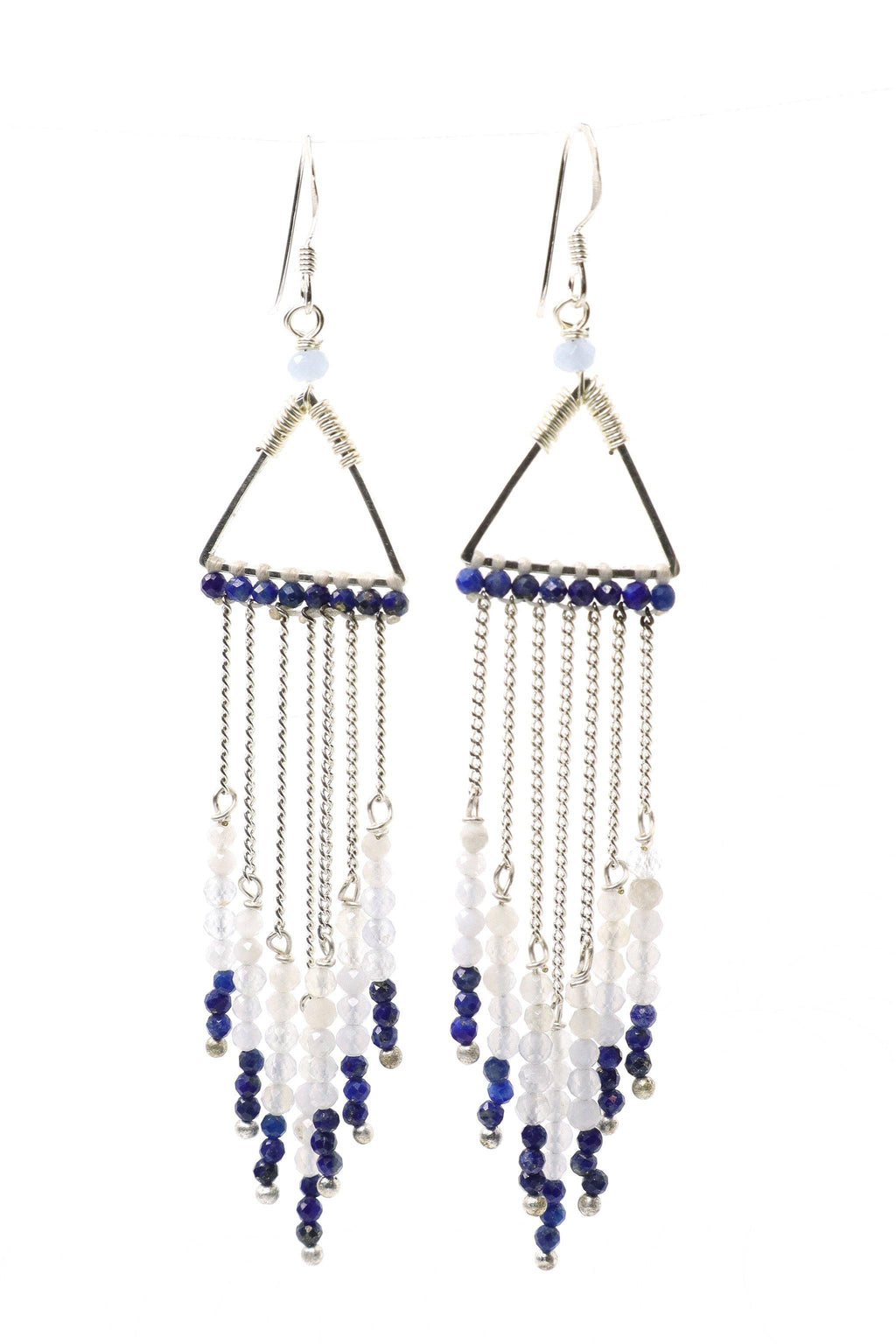 These waterfall statement earrings are a show stopper. They feature beautiful, faceted white quartz, crystal quartz, and lapis lazuli gemstones hanging from a silver triangle in graduated tones from light to dark. They are handmade with love in Thailand. This is a Fairtrade Product.
