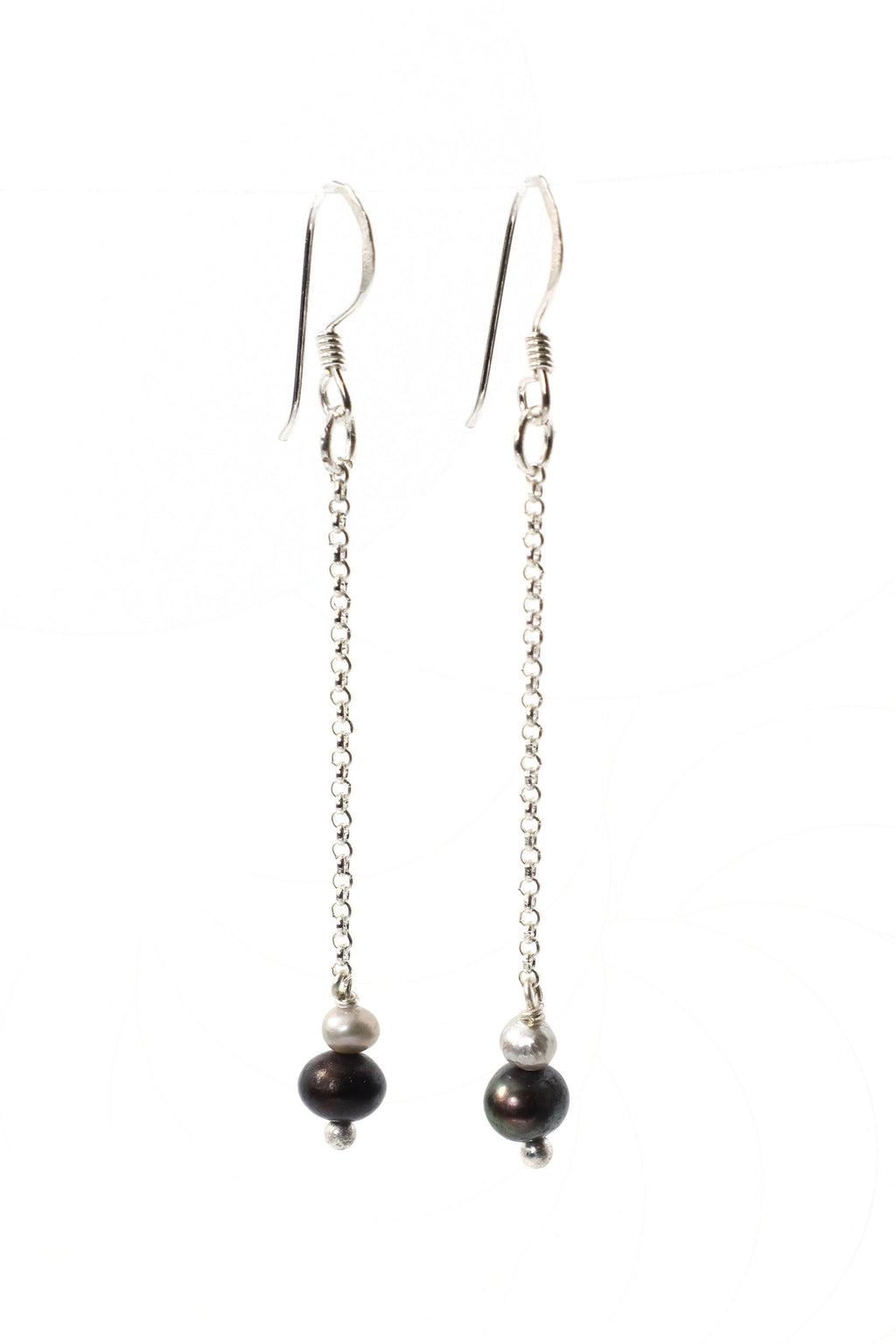 This is a drop style pearl earring on a silver chain. These earrings are handmade with love in Thailand.   This is a Fairtrade Product.