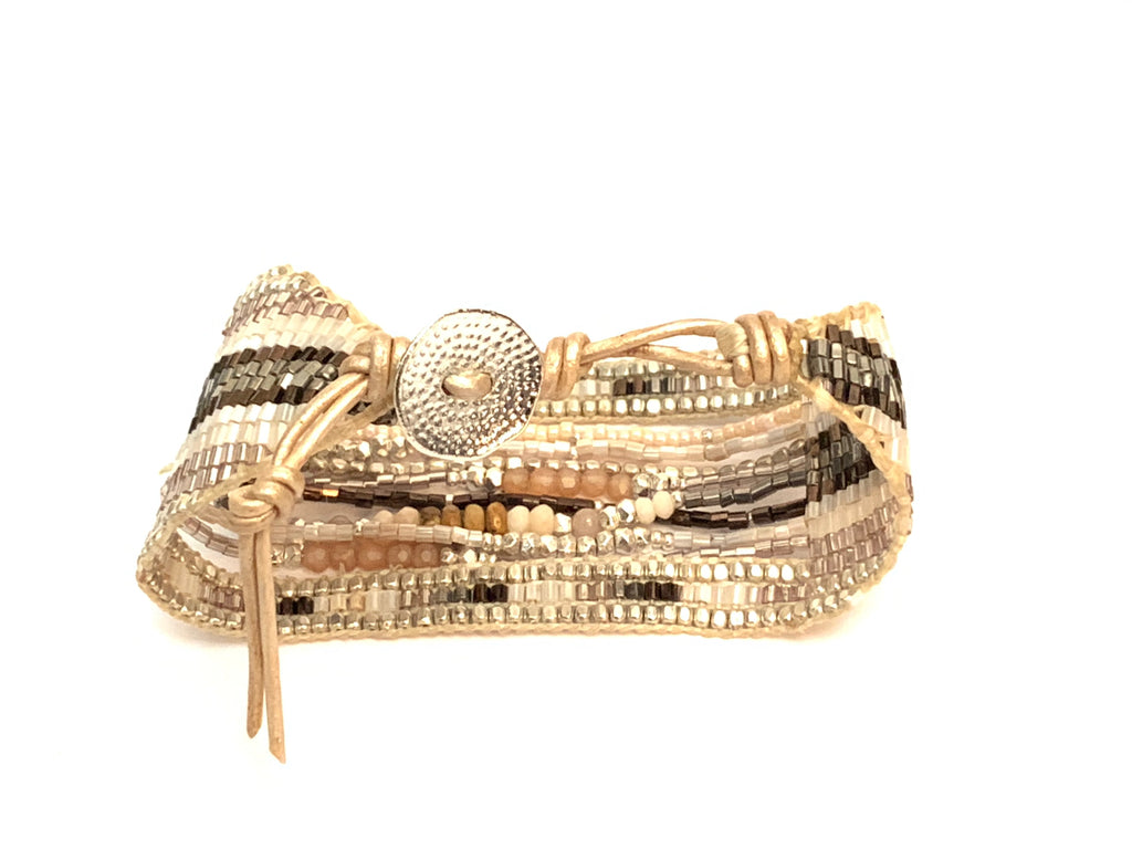 Closure view of the white and brown multi strand cuff bracelet from Filosophy