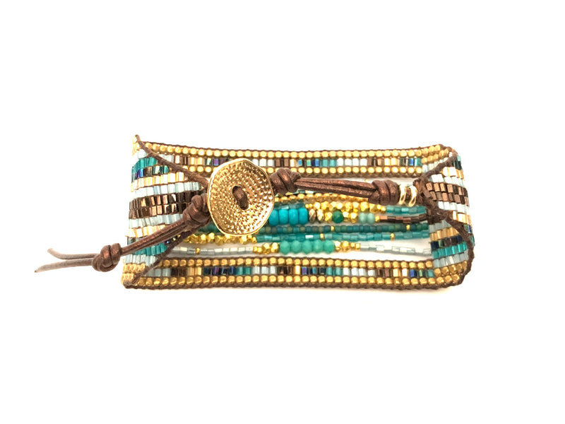 The closure side of the Carina Bracelet in turquoise and brown. It is a cuff bracelet with multiple strands in the center, giving it a layered feel with in one piece.