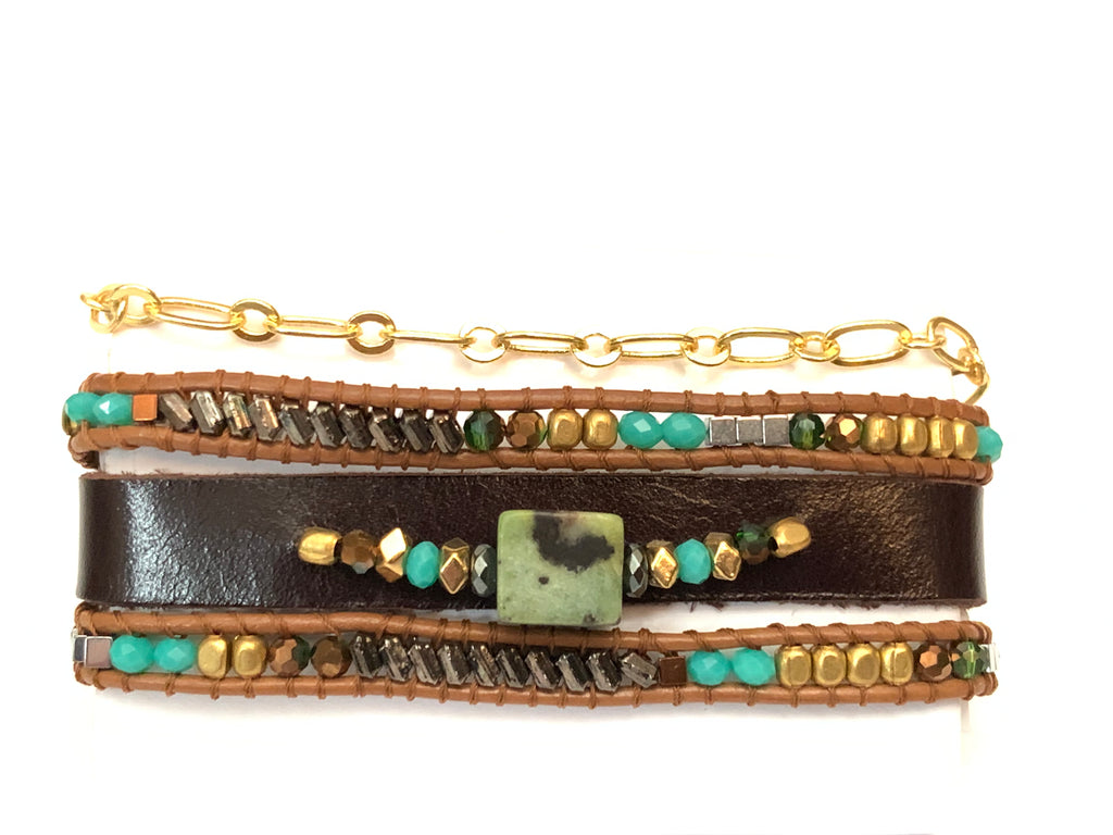 This is an exceptionally designed wrap bracelet that gives the appearance of two beaded wraps, a bracelet of leather with gemstones sewn into it, and a gold chain that adds the delicate charm to this bohemian bracelet wrap.