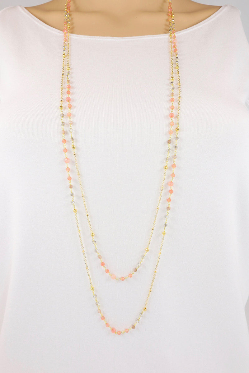 The Catalina necklace is a layered gemstone necklace. It features components of both rosary style gemstones mixed with chain. This necklace is handmade with strawberry quartz and smokey crystals. This is a versatile necklace that can be worn long, mid-length or short.