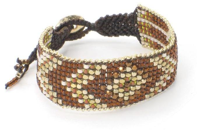 This is a diamond pattern seed bead cuff bracelet. The brown Miyuki seed beads combined with brass and copper beads make this cuff bracelet sparkle. This is a fairtrade, handmade bracelet from Thailand.