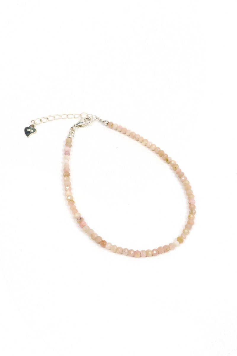 This is a dainty gemstone bracelet made with 2mm faceted rhodonite gemstone and a sterling silver clasp.