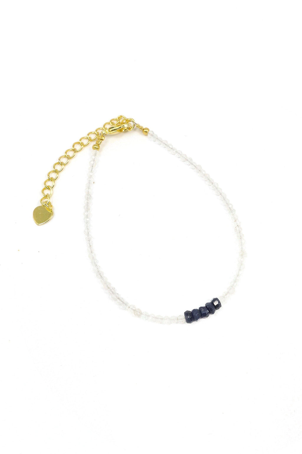 This is a dainty gemstone bracelet made with two tones. The moonstone is a 2mm faceted gemstone, and the sapphire is 3mm. The white subtlety with a center focus of Saphire. It is finished with and a sterling silver clasp.