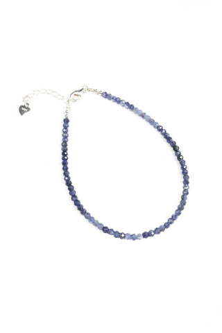 This is a dainty gemstone bracelet made with 2mm faceted sodalite gemstones and a sterling silver clasp.