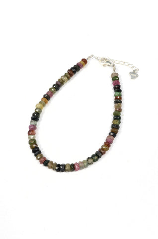 This is a beautiful watermelon tourmaline gemstone bracelet made with 3mm faceted tourmaline gemstones and a sterling silver clasp.