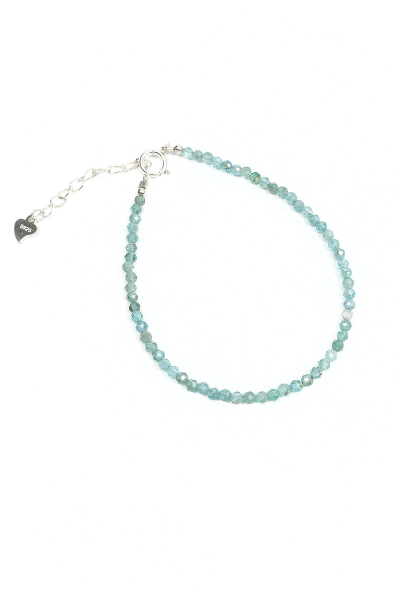 This is a dainty gemstone bracelet made with 2mm faceted Apatite gemstones and a sterling silver clasp.