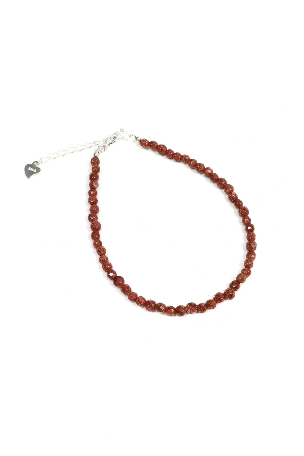 This is a dainty gemstone bracelet made with 2mm faceted Sandstone gemstones and a sterling silver clasp.