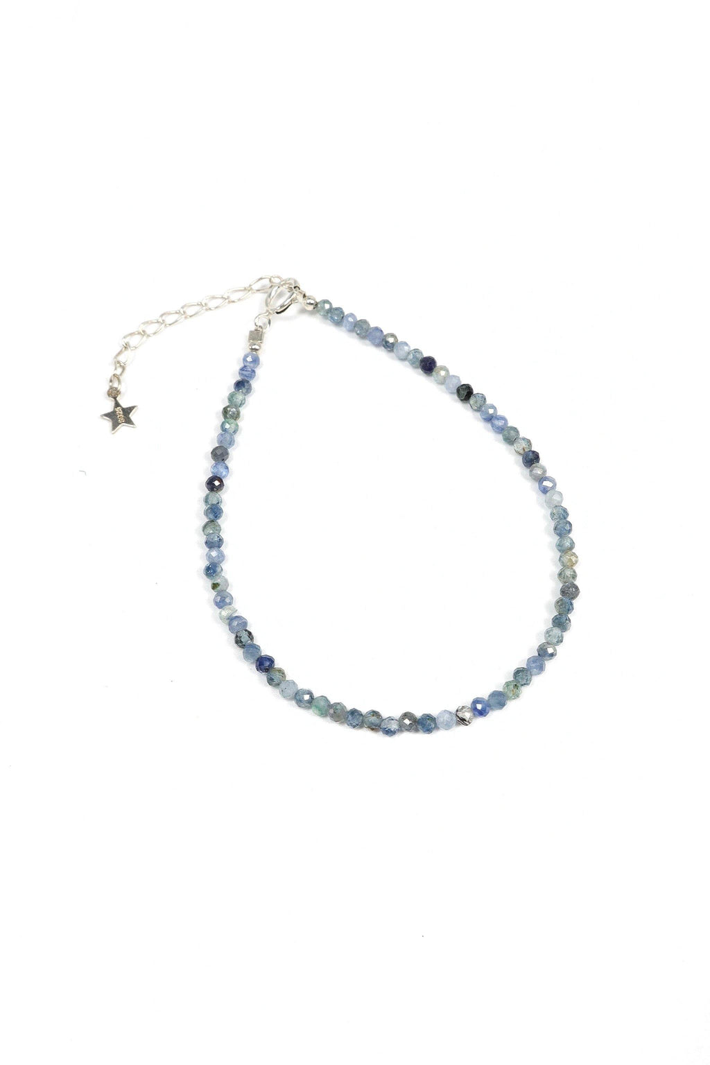 This is a dainty gemstone bracelet made with 2mm faceted Iolite gemstones and a sterling silver clasp