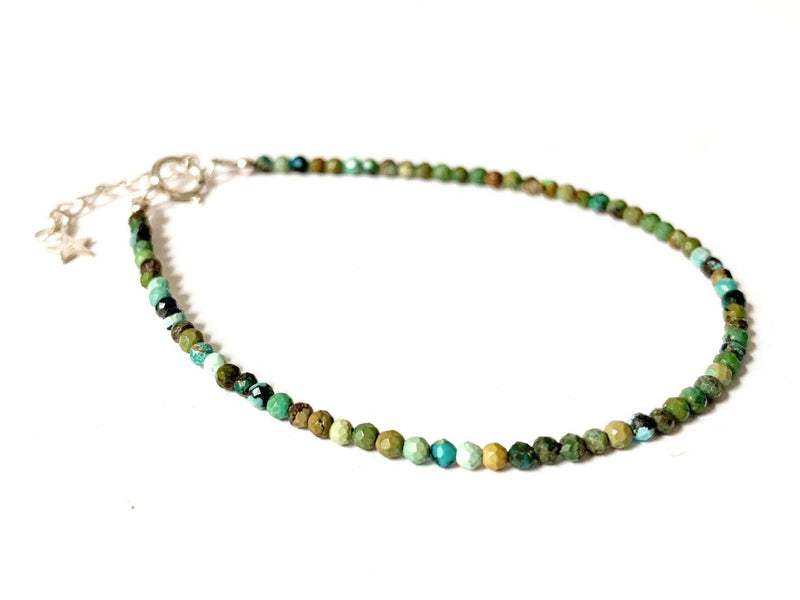 This is a dainty gemstone bracelet made with 2mm faceted African Turquoise gemstones and a sterling silver clasp.