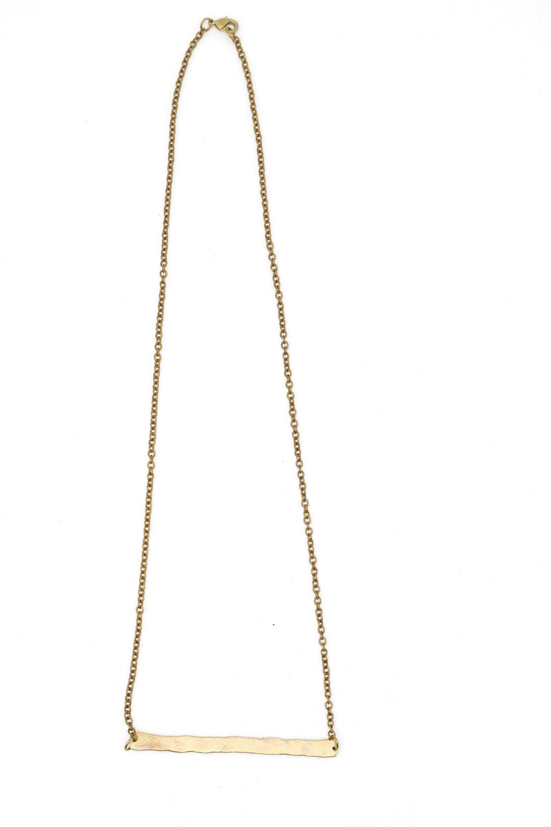 This is a hammered bar necklace made from brass. This is a fairtrade product from Thailand.