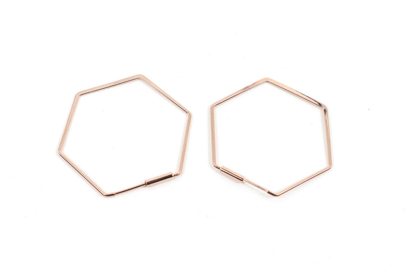 These geometric hexagon hoop earrings are a new take on hoops. They are rose gold plated rhodium. This is a handmade and fairtrade product from Thailand.