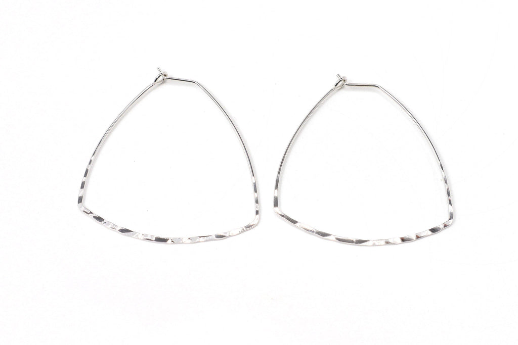 This is a unique take on a triangle style earring. It features a round triangle shape with a hammered bottom edge. This is a handmade, fairtrade product from Thailand.