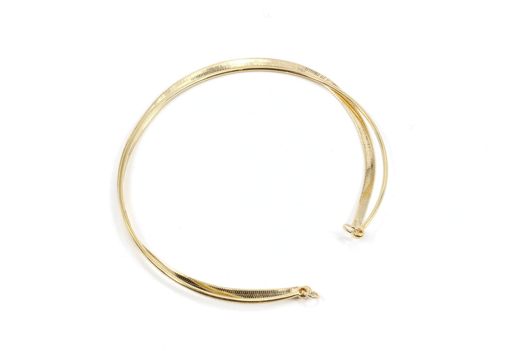 This thin gold cuff bracelet is elegantly understated. It features both a gold herringbone chain, combined with a thin, simple cuff. This is a classic bracelet for anyone's collection because it will go with anything. Wear it with your favorite pair of jeans to dress them up, or put it on with an evening dress for a subtle touch of class. We love this piece because it is so versatile.