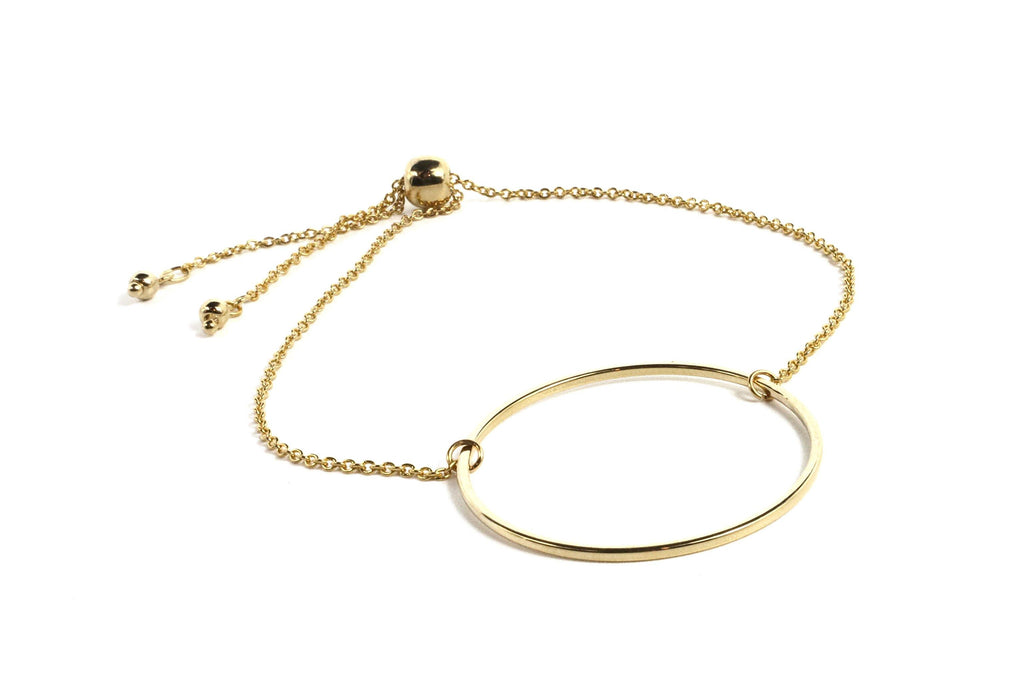 If you want that simple, elegant bracelet that is classy, with a minimalistic style, you will love this bracelet. It features a circle on a chain, with a convenient draw bead that makes it so easy to get off and on. Simply pull the bead all the way to the end of the chains, slide it on, then cinch the bead up for a perfect fit on any wrist.