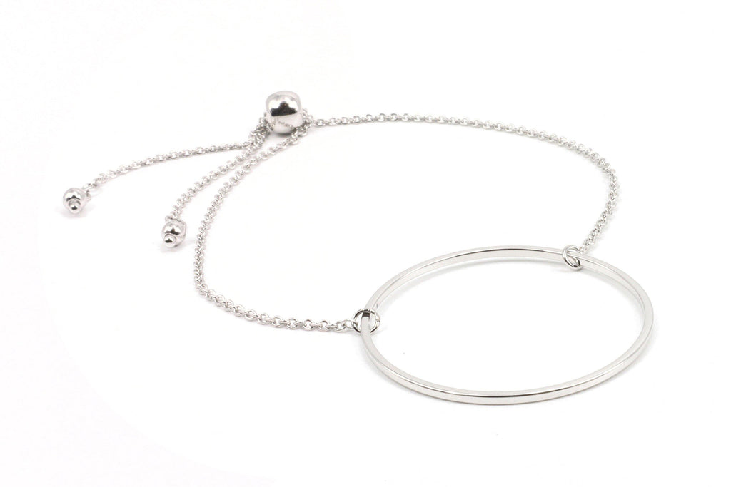 If you want that simple, elegant bracelet that is classy, with a minimalistic style, you will love this bracelet. It features a circle on a chain, about the size of a silver dollar, with a convenient draw bead that makes it so easy to get off and on. Simply pull the bead all the way to the end of the chains, slide it on, then cinch the bead up for a perfect fit on any wrist.