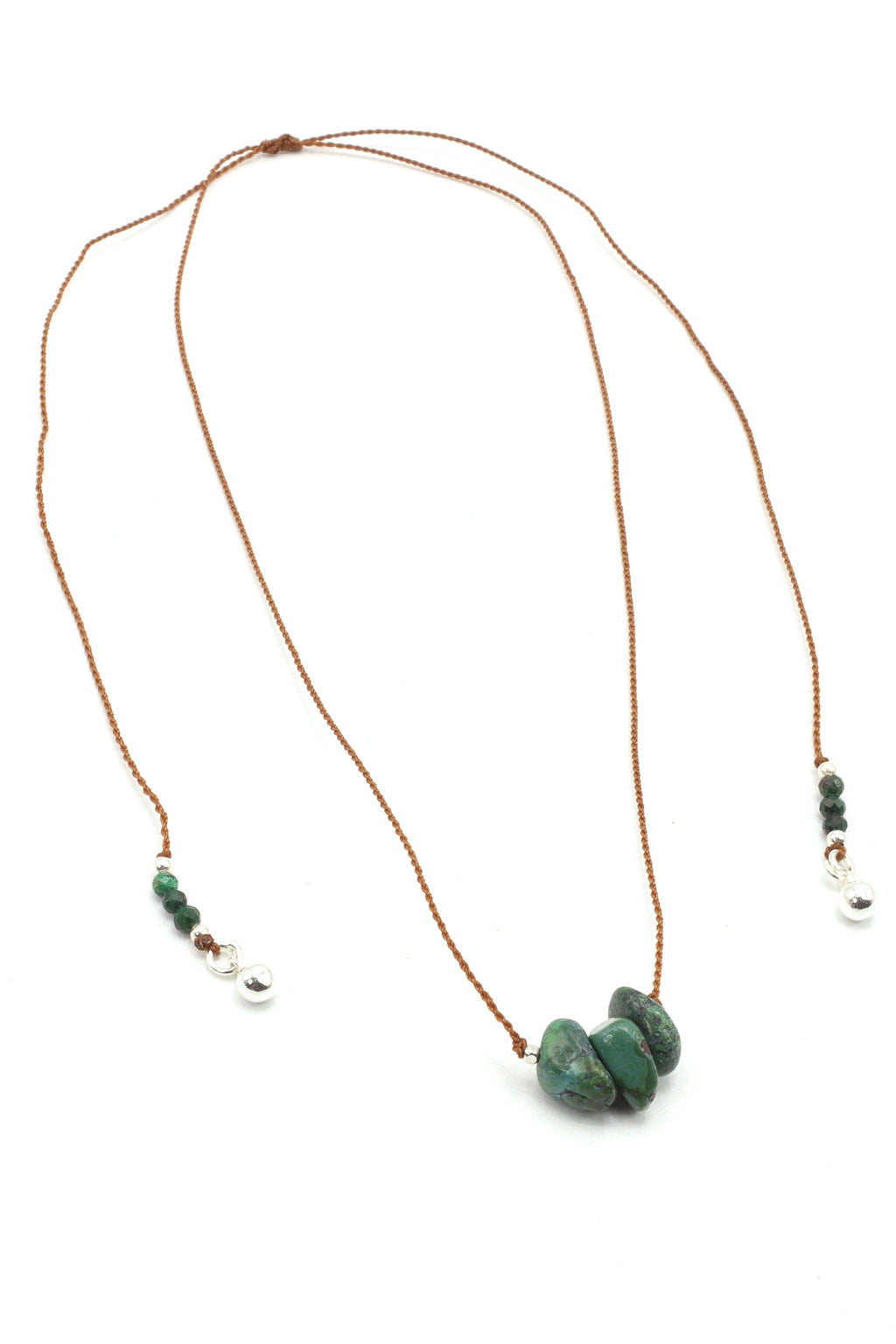 This gemstone choker Necklace is made with tumbled chrysocolla gemstones on a silk cord that has an adjustable slide knot, allowing you to wear this necklace as a comfortable choker.   This necklace is so simple, yet totally powerful. You could call it a Goddess Gemstone Necklace because it's frequency increases one's capacity to love, gain personal power, and have self-awareness. When you wear it at your throat chakra you will speak your truth, from your heart, with wise communication.