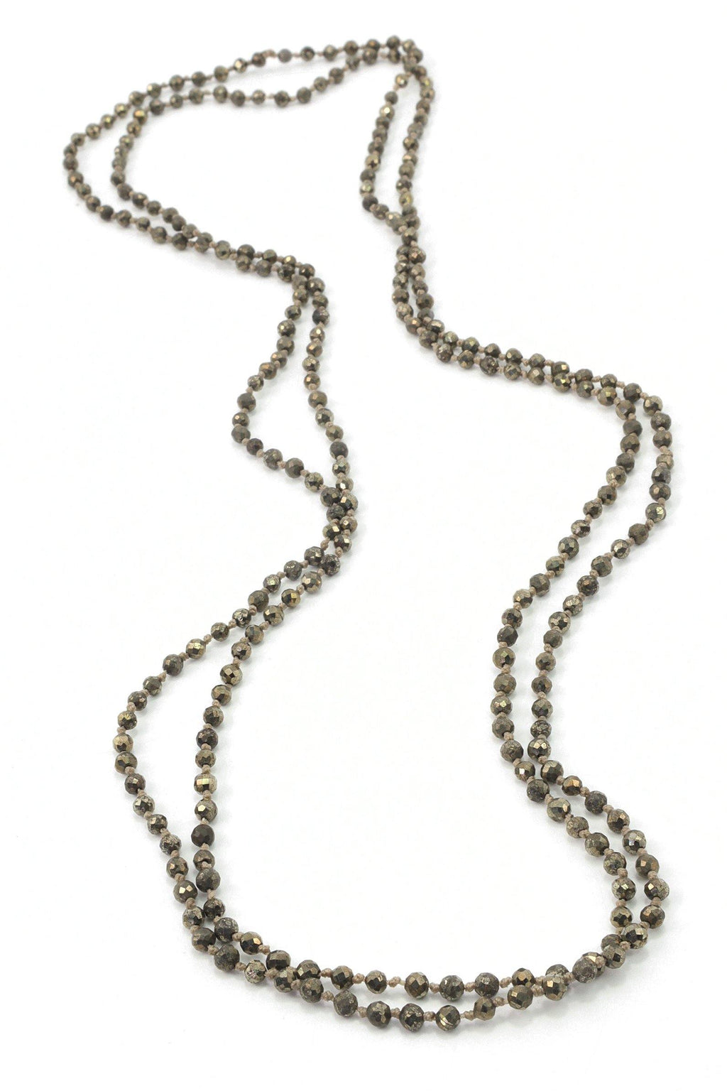 This pyrite necklace is a long knotted necklace that can be used as a short or long choker. A pyrite stone necklace is also known as fool's gold because of its silvery gold metallic color. This also looks like a metallic stone the way it shimmers in the light. But this hand knotted gemstone necklace will come in so handy with your casual wardrobe because it's neutral color pallet can be worn with anything in the earthy tones